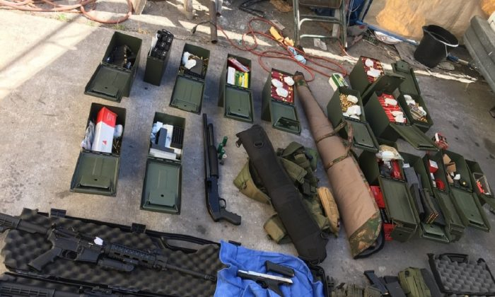 Guns, magazines, and ammunition were among the items found in a search of Rondolfo Montoya's residence, police said. (Long Beach Police Department)