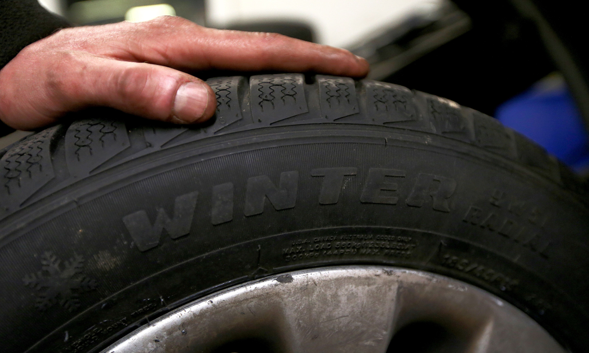 Car Mechanic Bounces Tires Like a Basketball