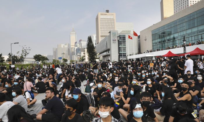 Students and others gather during a demonstration at Edinburgh Place in Hong Kong on Aug. 22, 2019. High school students thronged a square in downtown Hong Kong to debate political reforms as residents plan for further anti-government protests. (Vincent Yu/AP)