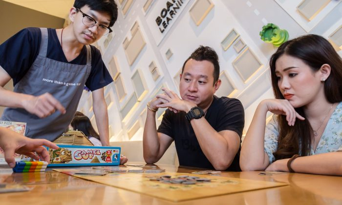 Boardgames can give the hippocampus and prefrontal cortex regions of the brain and helpful workout. (WHYFRAME/Shutterstock)