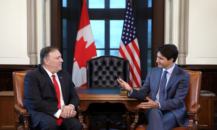 Canada's Prime Minister Justin Trudeau meets with U.S. Secretary of State Mike Pompeo in Trudeau's office on Parliament Hill in Ottawa, Ontario, Canada on Aug. 22, 2019. (Chris Wattie/Reuters)