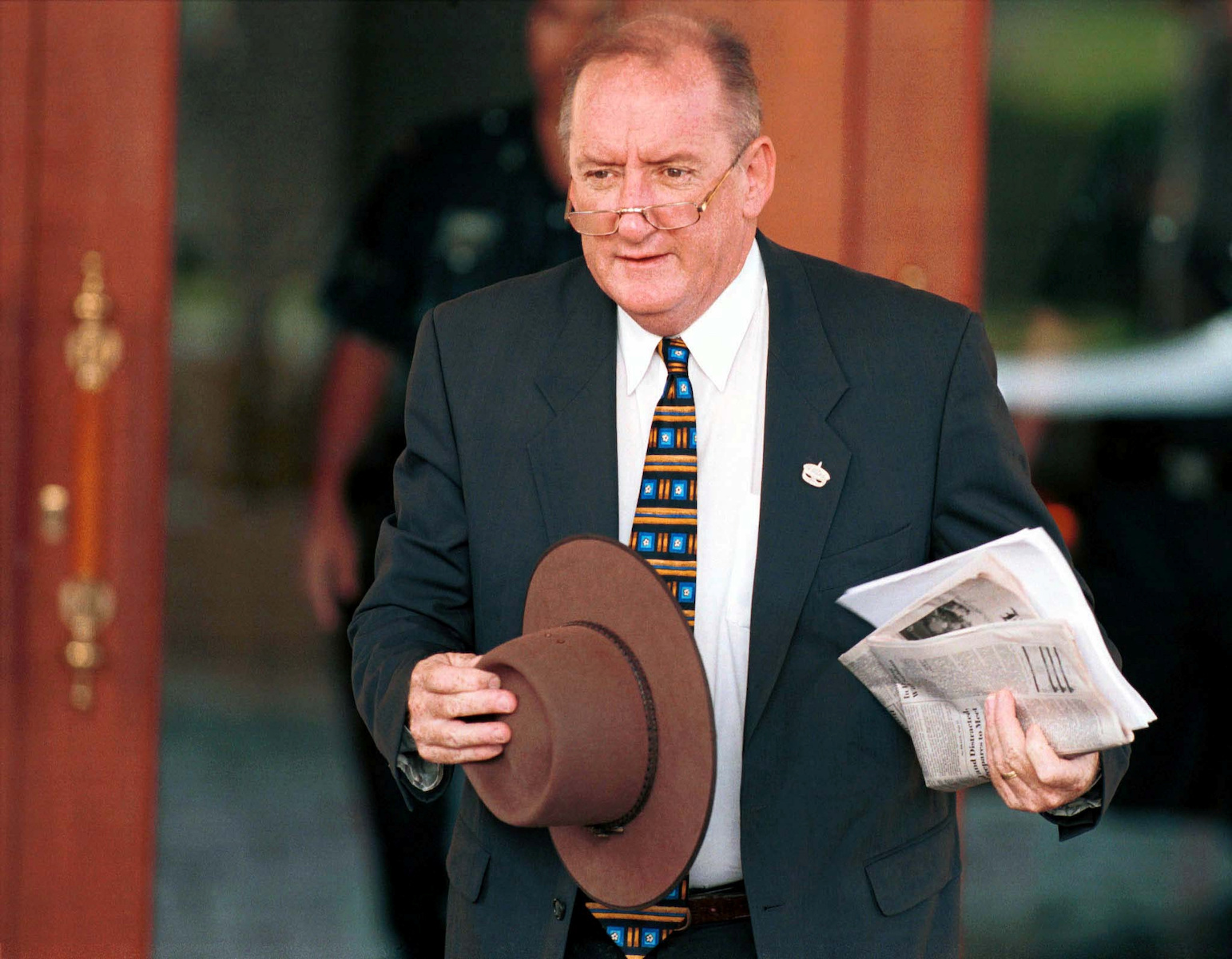 FILE PHOTO: Australian Trade Minister Tim Fischer arrives for the second day of the 10th Asia-Pacific Economic C..