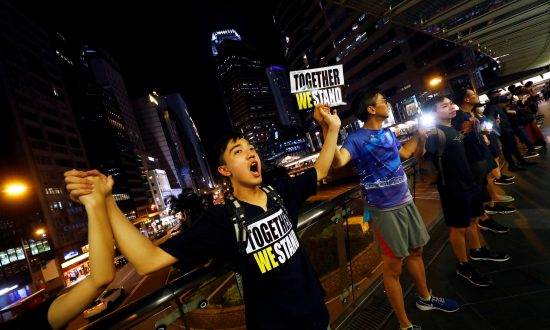 Hong Kong Families Form Peaceful Human Chains Ahead of Airport Protest