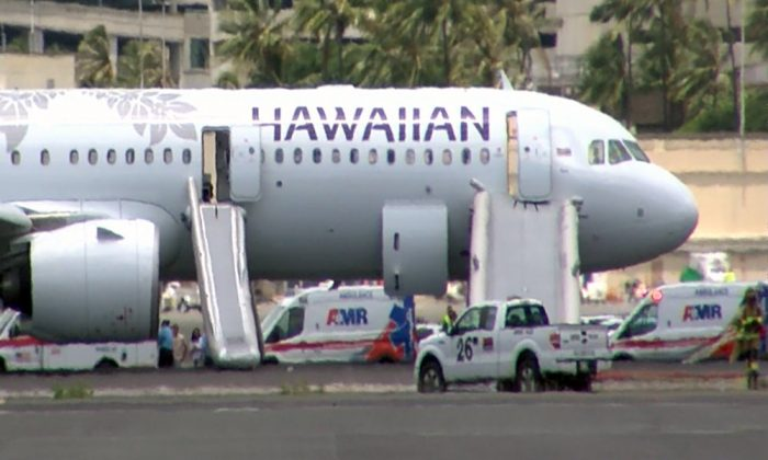 This image taken from video provided by Hawaii News Now, shows Hawaiian Airlines Flight 47 on a runway after smoke filled the plane's cabin, forcing an emergency landing and evacuation on Aug. 22, 2019 in Honolulu. (Hawaii News Now via AP)
