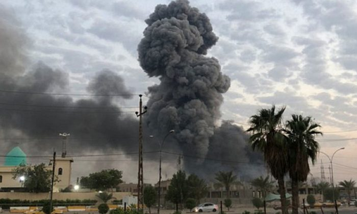 Plumes of smoke rise after an explosion at a military base southwest of Baghdad, Iraq , on Aug.12, 2019. (Loay Hameed/AP Photo/File)
