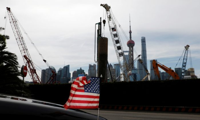 A U.S. flag on an embassy car is seen outside a hotel near a construction site in Shanghai, China on July 31, 2019. (Aly Song/Reuters)