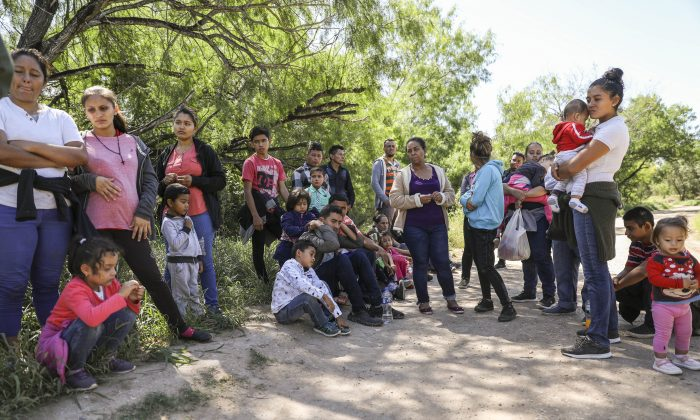 A group of illegal aliens who have just crossed the Rio Grande from Mexico near McAllen, Texas, on April 18, 2019. (Charlotte Cuthbertson/The Epoch Times)