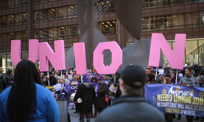 Members of the Service Employees International Union (SEIU) hold a rally in support of the American Federation of State County and Municipal Employees (AFSCME) union at the Richard J. Daley Center plaza on Feb. 26, 2018 in Chicago, Ill. (Scott Olson/Getty Images)