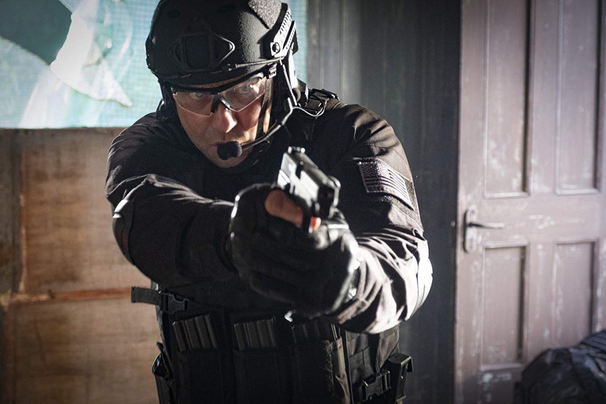 man with helmet and gun