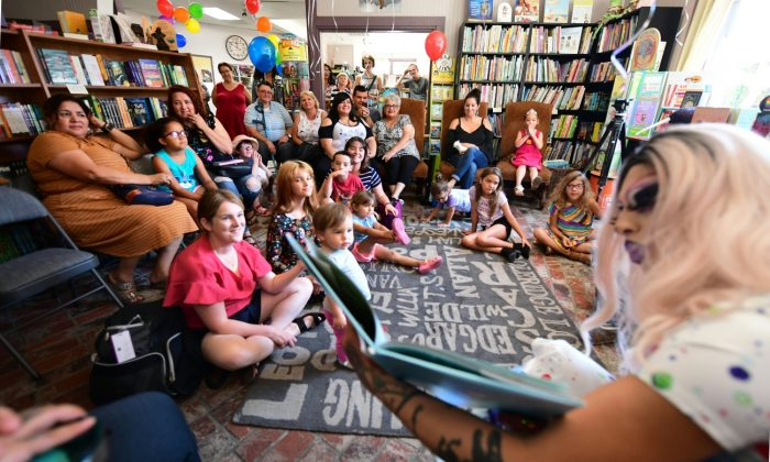 A drag queen reads to adults and children in Riverside, Calif., on June 22, 2019. (Frederic J. Brown/AFP/Getty Images)