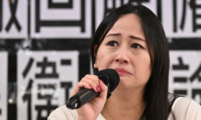 Hong Kong Dragon Airlines Flight Attendants Association chairperson Rebecca Sy, who was dismissed from her position as a flight attendant for Cathay Pacific's low-cost subsidiary Cathay Dragon, reacts during a press conference in Hong Kong on August 23, 2019. (ANTHONY WALLACE/AFP/Getty Images)