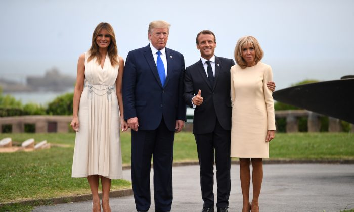 President Donald Trump (2nd L), First Lady Melania Trump (L), French President Emmanuel Macron (2nd R), his wife Brigitte Macron pose for a photograph ahead of a working dinner at the Biarritz lighthouse in Biarritz, France on Aug. 24, 2019. (Neil Hall-Pool/Getty Images)