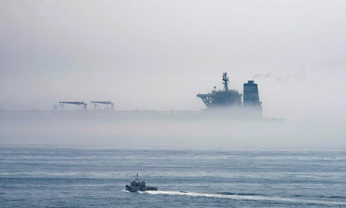 A view of the Grace 1—now known as Adrian Darya 1—supertanker is seen through the sea fog, in the British territory of Gibraltar, on Aug. 15, 2019. It was seized in July in a British Royal Navy operation off Gibraltar. (AP Photo/Marcos Moreno)