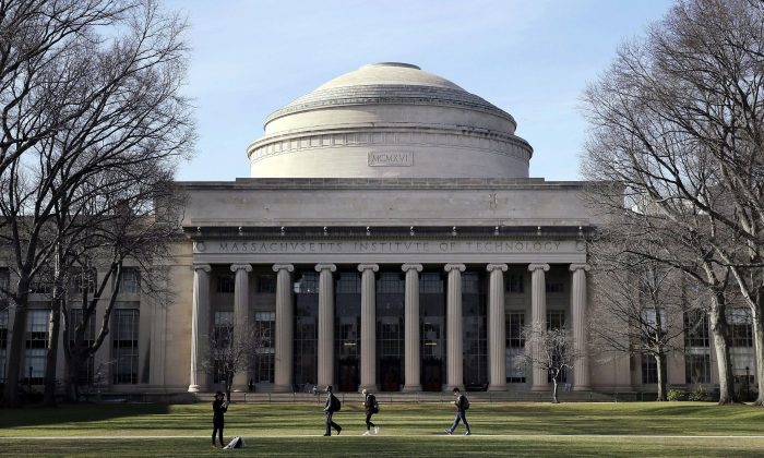 """Students walk past the """"Great Dome"""" atop Building 10 on the Massachusetts Institute of Technology campus in Cambridge, Mass., on April 3, 2017. (Charles Krupa/AP Photo)"""