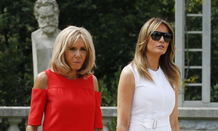 French President's wife Brigitte Macron and U.S. First Lady Melania Trump (R) arrive to attend a traditional dance performance with the other G7 leaders' spouses at the Villa Arnaga in Cambo-les-Bains during a visit on traditional Basque culture, near Biarritz as part of the G7 summit, on Aug. 25, 2019. (Regis Duvignau/AFP/Getty Images)