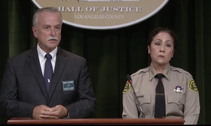 Capt. Kent Wegener (L) and Asst. Sheriff Sheriff Robin Limon said at a press conference of Aug. 24, 2019, that deputy Angel Reinosa admitted to fabricating the sniper shooting that resulted in a massive response earlier in the week. (Los Angeles County Sheriff's Department)
