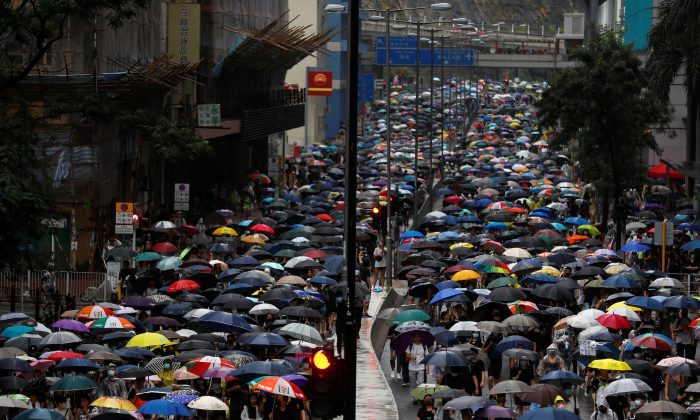 People march during a protest in Kwai Fong, in Hong Kong, on Aug. 25, 2019. (Kai Pfaffenbach/Reuters)