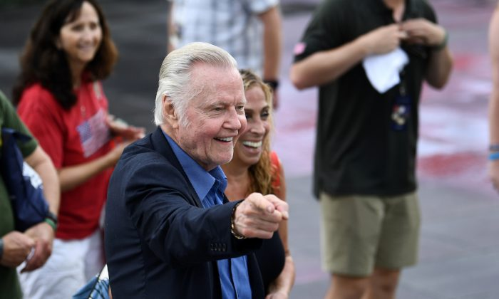 """American actor Jon Voight greets people as they gather on the National Mall ahead of the """"Salute to America"""" Fourth of July event with President Donald Trump at the Lincoln Memorial in Washington on July 4, 2019. (Photo by Brendan Smialowski/AFP/Getty Images)"""
