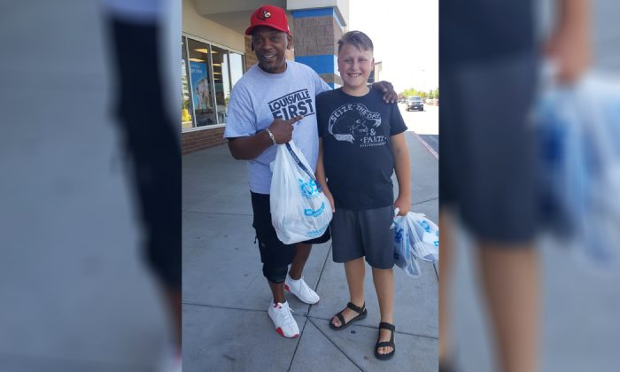 Lito Mason (L) bought Zachary Stone, 11, a a pair of shoes at Boise, Idaho, on July 25, 2019. (Courtesy of Malissa Manguso/Facebook)