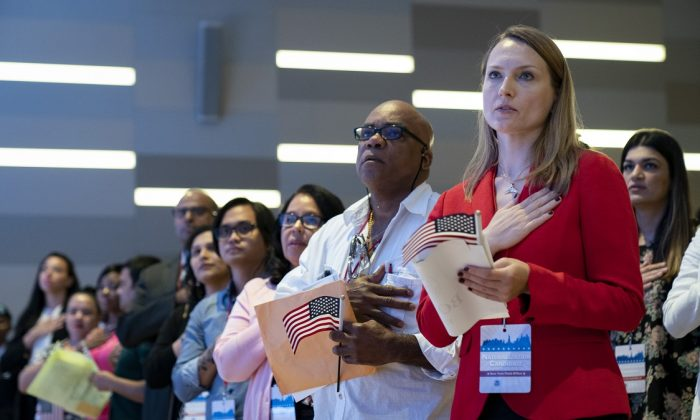 New U.S. citizens stand for the Pledge of Allegiance during a naturalization ceremony in New York City on July 2, 2019. (Drew Angerer/Getty Images)