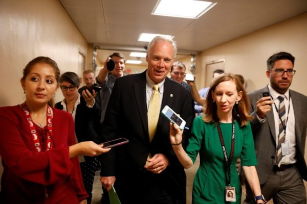 Senator Ron Johnson (R-WI) speaks with reporters ahead of today's vote on the health care bill on Capitol Hill in Washington