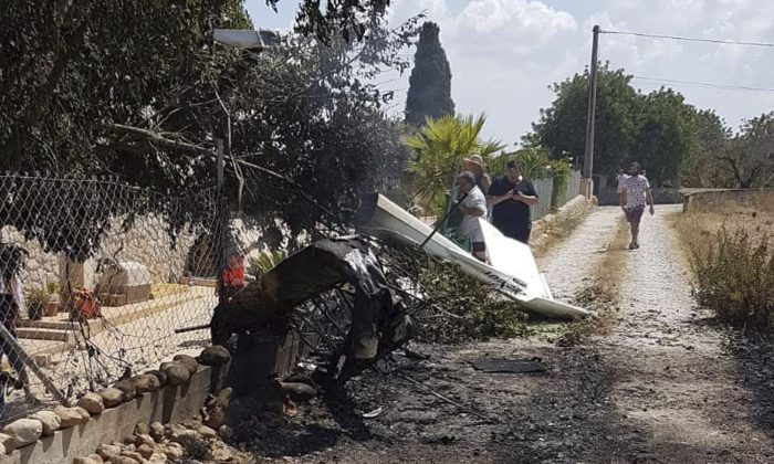 This photo provided by Incendios f.Baleares shows wreckage by a fence near Inca in Palma de Mallorca, Spain on Aug. 25, 2019. (Incendios f.Baleares via AP)