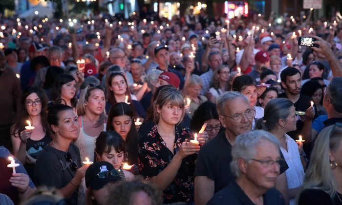 Mourners attend a memorial service in the Oregon District to recognize the victims of an early-morning mass shooting in the popular nightspot on August 04, 2019 in Dayton, Ohio. (Scott Olson/Getty Images)