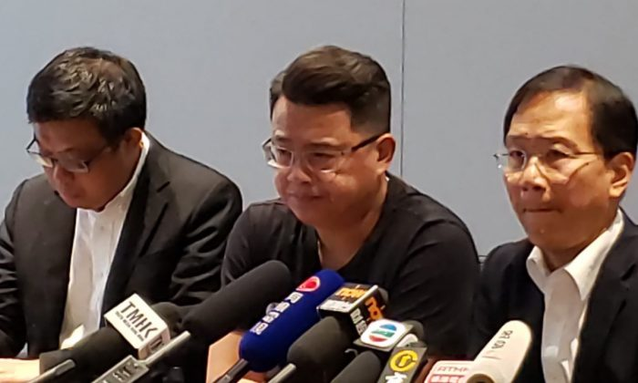 (L-R) Pro-democracy camp politicians James To, Andrew Wan, and Kwok Ka-ki hold a press conference in Hong Kong on Aug. 26, 2019. (Sarah Liang/The Epoch Times)