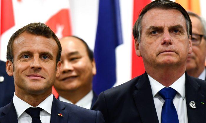 France's President Emmanuel Macron and Brazil's President Jair Bolsonaro attend an event on women's empowerment during the G20 Summit in Osaka on June 29, 2019. (Brendan Smialowski/AFP/Getty Images)