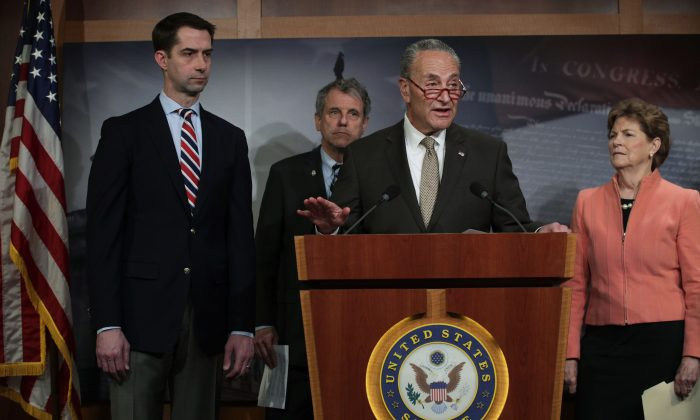 U.S. Senate Minority Leader Sen. Chuck Schumer (D-NY) speaks as (L-R) Sen. Tom Cotton (R-AR), Sen. Sherrod Brown (D-OH) and Sen. Jeanne Shaheen (D-NH) listen during a news conference at the U.S. Capitol in Washington, D.C. on April 4, 2019. The lawmakers are unveiling bipartisan legislation that aims to regulate the trafficking of fentanyl into the U.S. from China. (Alex Wong/Getty Images)
