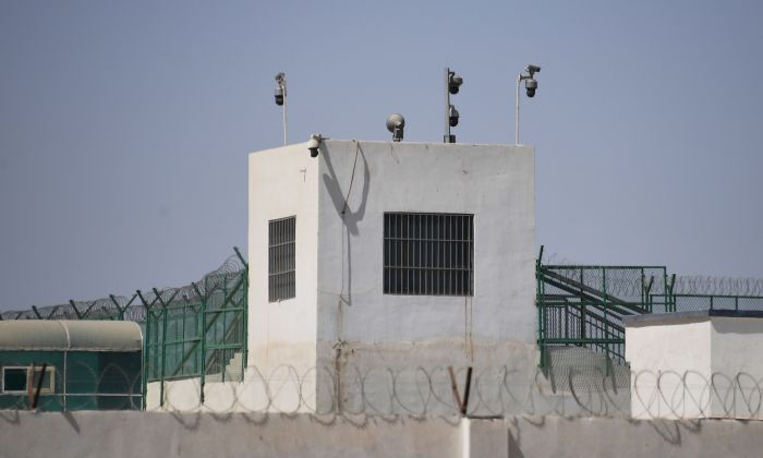 The outer wall of a believed re-education camp is equipped with several surveillance cameras in China's northwestern Xinjiang region on May 31, 2019. (GREG BAKER/AFP/Getty Images)