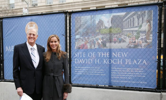Philanthropist David H. Koch and wife Julia Koch stand in the future site of the new David H. Koch Plaza during the Fifth Avenue Plaza Groundbreaking at the Metropolitan Museum of Art on January 14, 2013 in New York City.  (Astrid Stawiarz/Getty Images)