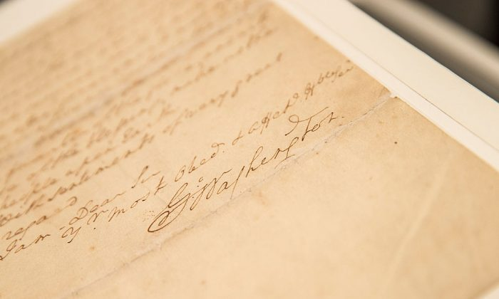The signature of George Washington on a letter he wrote regarding the United States' constitution. (Andrew Burton/Getty Images)