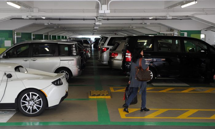A woman in a parking garage in China in this file photo. (Laurent Fievet/AFP/Getty Images)