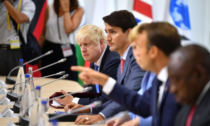 L-R: British Prime Minister Boris Johnson, Canadian Prime Minister Justin Trudeau, German Chancellor Angela Merkel and French President Emmanuel Macron attend a working lunch during the G7 Summit in Biarritz, France, on Aug. 26, 2019. (Jeff J Mitchell/Getty Images)