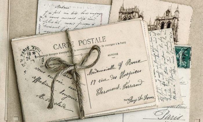 Old family letters in cursive handwriting. (Shutterstock)