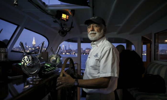 Captain Greg Freitas on the Full Moon yacht on the Hudson River near New York City on Aug. 16, 2019. (Samira Bouaou/The Epoch Times)