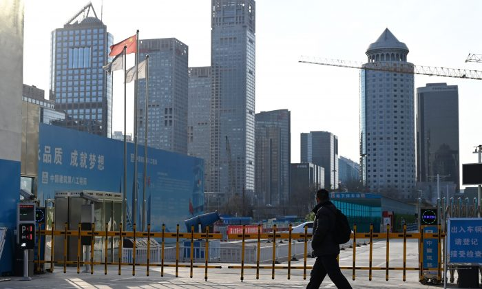 A man walks past the entrance to a construction site in Beijing on Feb. 11, 2019. (Greg Baker/AFP/Getty Images)