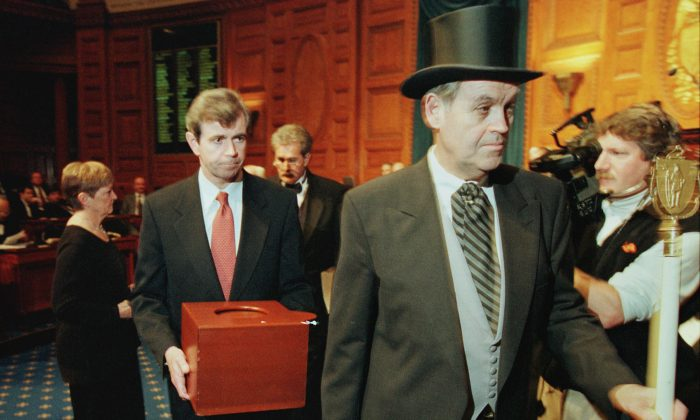 Massachusetts Secretary of the Commonwealth William Galvin, center, carries a ballot box containing the 12 Massachusetts electoral votes for Vice President Al Gore as he is led by Sergeant-at Arms Michael Rea, right, during the Electoral College voting at the Statehouse December 18, 2000 in Boston.  Pool Photo/Getty Images