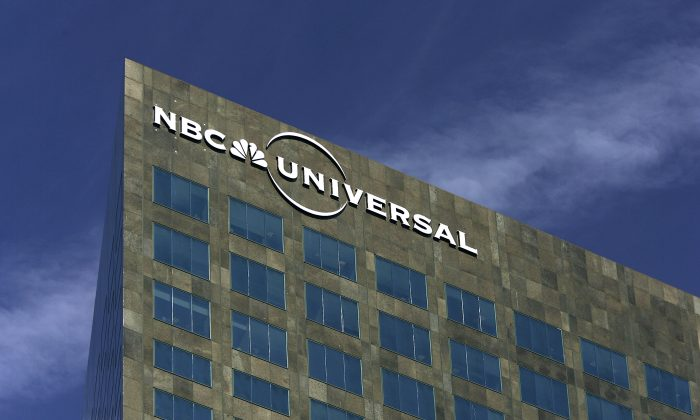 The NBC Universal logo is seen on its headquarters building in Los Angeles, Calif., in a file photograph. (David McNew/Getty Images)