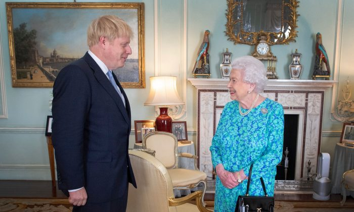 Britain's Queen Elizabeth II welcomes newly elected leader of the Conservative party, Boris Johnson during an audience in Buckingham Palace, London on July 24, 2019. (Victoria Jones/AFP/Getty Images)