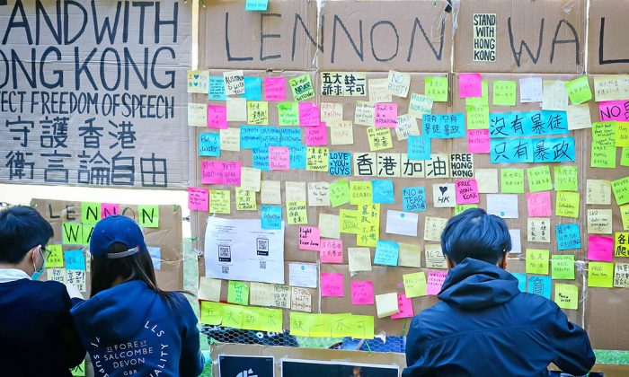People post notes on a makeshift Lennon Wall to support the Hong Kong democracy movement at the University of Queensland in Brisbane, Australia, on Aug. 9, 2019. (Patrick Hamilton/AFP/Getty Images)