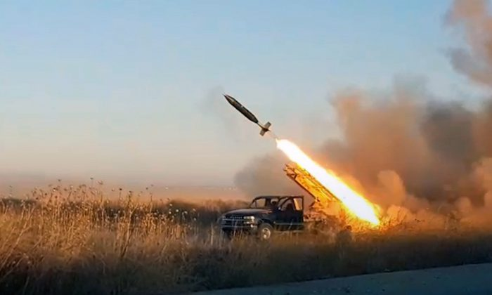 This photo provided by the Ibaa News Agency, the media arm of al-Qaida-linked Hayat Tahrir al-Sham militant group in Syria, purports to show a missile fired by the militant group against Syrian government forces position in Idlib province, Syria, on Aug. 27, 2019. (Ibaa News Agency via AP)