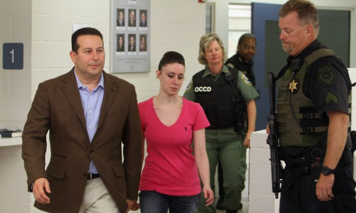 Casey Anthony (C) leaves with her attorney Jose Baez (L) from the Booking and Release Center at the Orange County Jail after she was acquitted of murdering her daughter Caylee Anthony in Orlando, Florida on July 17, 2011. (Photo by Red Huber-Pool/Getty Images)