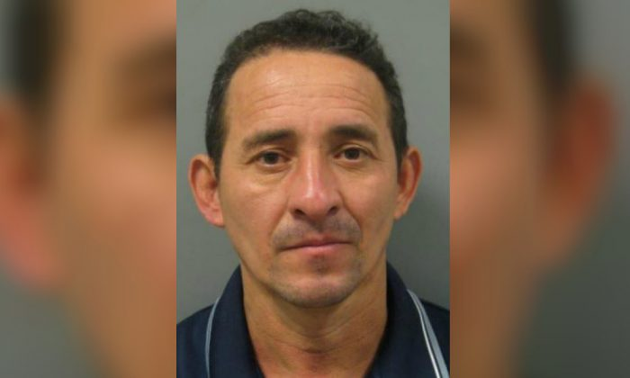 Nelson Reyes-Medrano, 46, is accused of raping a 16-year-old girl in her bedroom in Montgomery County, Maryland. (Montgomery County Police Department)