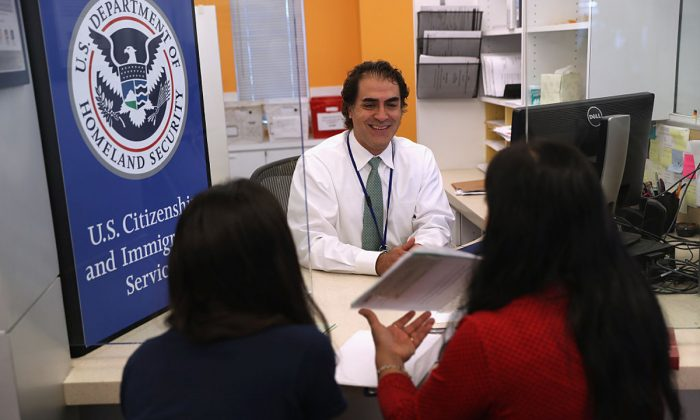 A U.S. Citizenship and Immigration Services (USCIS), officer interviews U.S citizenship applicants in the Dallas Field Office in Irving, Texas on Aug. 22, 2016. (John Moore/Getty Images)