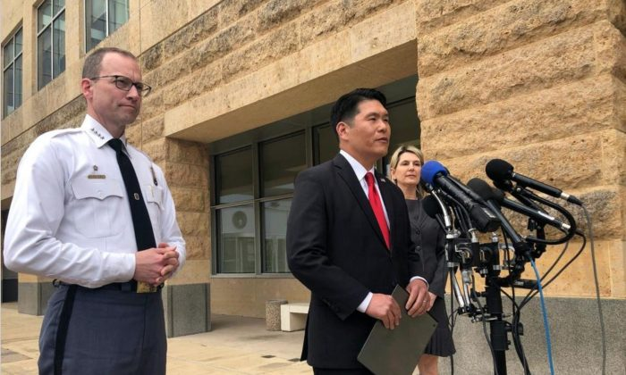 Prince George's County Police Chief Henry Stawinski (L), U.S. Attorney Robert Hur, and FBI special agent Jennifer Moore address reporters outside the federal courthouse in Greenbelt, Md., after a detention hearing for Rondell Henry on April 9, 2019. (Michael KunzelmanAP Photo)