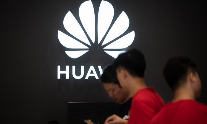 Employees work at a Huawei store in Dongguan, China, on Aug. 9, 2019. (Fred DufourAFP/Getty Images)