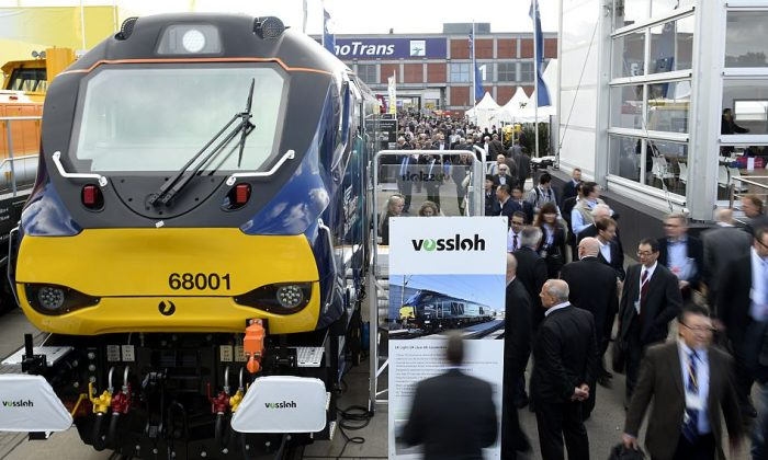 Fairgoers take a look on a displayed Eurolight train by Vossloh during the opening day of the Innotrans International Trade Fair for Transport and Mobility in Berlin on Sept. 23, 2014. (Tobias Schwarz/AFP/Getty Images)