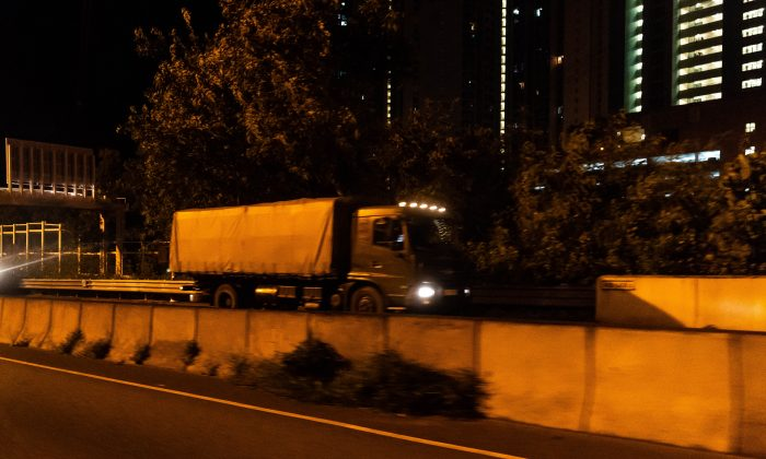 China's People's Liberation Army (PLA) military vehicles move into Hong Kong in the early hours of Thursday, as China's state-run media Xinhua reported that it was a routine annual rotation, in Hong Kong on August 29, 2019. (Billy H.C. Kwok/Getty Images)